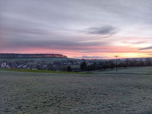 Blick auf Dittlofsroda im Morgenrot